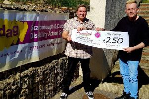 Proudfoot presents the cheque for �250 to Scarborough DAG.