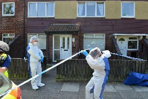 Forensic officers at a house in High Street, Jarrow, after a man's body was discovered on Tuesday.
