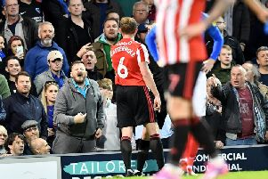 A Portsmouth fan reacted angrily to Sunderland midfielder Luke O'Nien falling over the advertising boards.