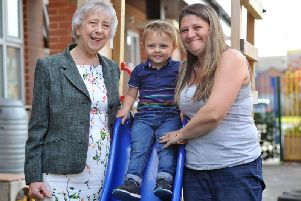 Councillor Moira Smith is pictured with Victoria Wallace and son Oden.