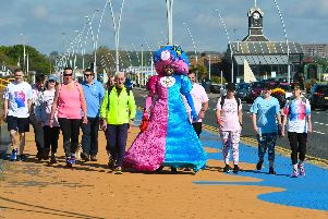 Colin Burgin-Plews and others take part in a charity walk around Bents Park in aid of the Chloe and Liam Together Forever Trust.