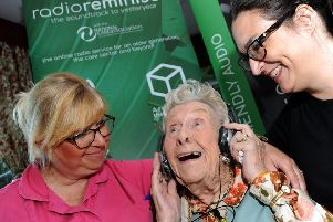 Mavis Corbett listens in to Radio Reminisce with activity co-ordinators, Donna (Dolly) Stanton and Rebekah Rowell at it's launch at the Spencer Grove  home on Springwood Gardens in Belper on Monday.