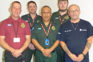 CFR John Ibbotson (front left) and patient John Beckingham (front right) with the ambulance crew Javed Chaudhary (front centre), Ian Nettleship (back right) and Alex Robson (back right).