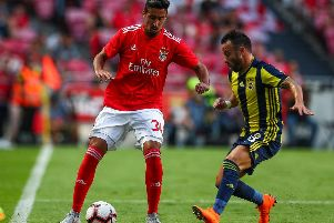 Andre Almeida of SL Benfica (L) vies with Mathieu Valbuena of Fenerbache SK (R) during the match between SL Benfica and Fenerbache SK for UEFA Champions League Qualifier at Estadio da Luz on August 7, 2018 in Lisbon, Portugal. (Photo by Carlos Rodrigues/Getty Images)