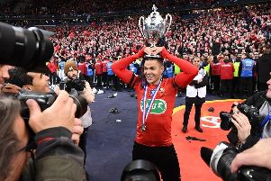 TOPSHOT - Rennes' French forward Hatem Ben Arfa celebrates with the trophy after winning the French Cup final football match between Rennes (SRFC) and Paris Saint-Germain (PSG), on April 27, 2019 at the Stade de France in Saint-Denis, outside Paris. (Photo by Anne-Christine POUJOULAT / AFP)        (Photo credit should read ANNE-CHRISTINE POUJOULAT/AFP/Getty Images)