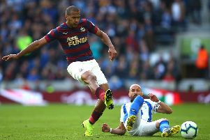 Salomon Rondon of Newcastle United is challenged by Bruno of Brighton and Hove Albion during the Premier League match between Brighton & Hove Albion and Newcastle United at American Express Community Stadium on April 27, 2019 in Brighton, United Kingdom. (Photo by Jordan Mansfield/Getty Images)