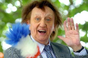 Ken Dodd, who has died at the age of 90.