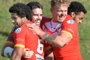 Happy - for now....Try scorer Josh Toole (centre) all smiles as he is congratulated by team-mates. Pic Steve Ellis