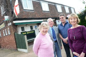 John Sissions (second left) with wife Mavis,  son David and daughter in law Christine outside the family pub.