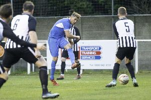Hemsworth MW's Jason Yates attempts a shot on goal in a recent game.