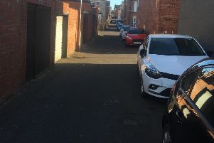 Cars parked in the back lane of Berkeley Street in South Shields.