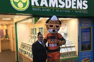 Ramsdens Area Manager Assistant Tuche Kaya with Castleford Tigers mascot JT, outside the Castleford branch.