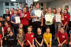 Members of Stage Door Youth Theatre with their certificates from the National Dramatic and Operatic Association. (s)