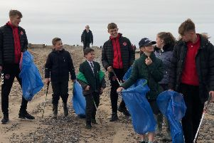 Towns U18s joined pupils from Shakespeare Primary School in litter picking on Fleetwood beach.