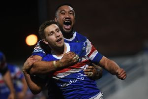 In at the double: Wakefield's Kyle Wood celebrates his second try with Tinirau Arona. 'Picture: Jonathan Gawthorpe