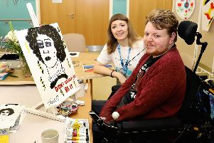 Phillip Hood is pictured with his painting and hospice art therapist Rachel Horne