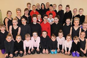 Stepping-Up school of theatre dance, in Dunscroft, is celebrating it's 10th anniversary. Principal Donna Pearce and her assistant Emmie Anderson, pictured with some of the dancers. Picture: NDFP-05-03-19-SteppingUp-1