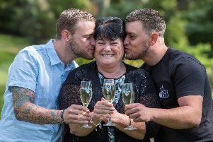 Winner Paula Williamson, centre, with her two sons, Jack (left) and Ian at Wentbridge House Hotel, Wentbridge, Pontefract. Picture: 'Jason Roberts/National Lottery/PA Wire