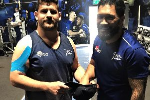 Former Pocklington player and England cap Rob Webber does the draw for the 2019 John Smiths Pock 7s with the help of his Sale teammate and Samoa international Johnny Lelota