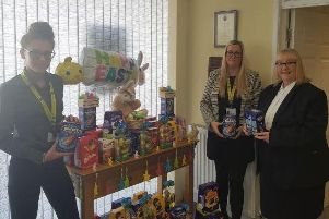 Trust staff members Courtney Andrew and Laura Peacock collecting the eggs from Angela Reader of J Steadman