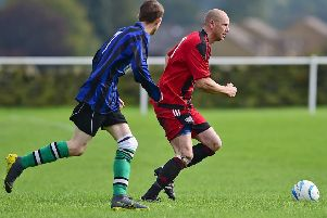 Christian Mulvihill on the ball for Lower Hopton during Saturday's West Riding County Challenge Cup tie against Fieldhead Hospital.