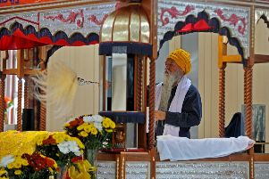 Worshipers at the Guru Nanak Gurdwara Sikh Temple, Huddersfield, celebrating the 550th anniversary of their founding guru.  Picture by Tony Johnson