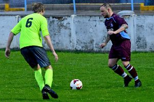 Litletown's Tom Swailes attempts to take on Gildersome Spurs defender Danny Norton during last season's Wheatley Cup final at Ossett Town. The beaten finalists will be aiming to go one better and they have reached the semi-finals after victory over Morley Town. Picture: Paul Butterfield