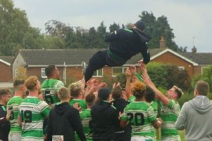 Dewsbury Celtic players launch coach Brendan Sheridan into the air following their promotion. Picture: Ash Milnes.