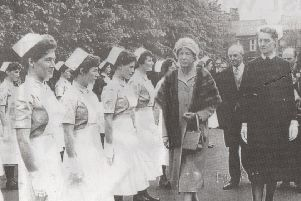Smart staff: Nurses at Staincliffe General Hospital stand in military style to be inspected by the Princess Royal who visited the hospital in 1960. She is accompanied by Sister Dorothea Wood. Note how their crisp white uniforms and starched caps, and they are even wearing gloves!
