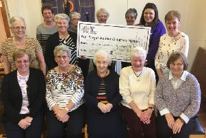 The Knit and Natter group recently handed over a cheque for �400 to Lou Addison, regional fundraiser for Forget Me Not children's hospice after their fundraising drive.
