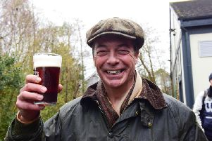 Nigel Farage enjoying a pint at the end of the first day of the March To Leave, from Sunderland to Hartlepool.
