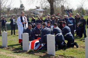 Ministry of Defence handout photo of the burial service with full military honours for World War Two Spitfire pilot Warrant Officer John Henry Coates at the Commonwealth War Graves Commission (CWGC) Padua War Cemetery in Italy.