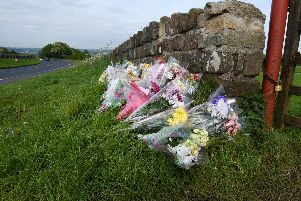 Flowers close to the scene in Parbold where Alex Davies' body was found
