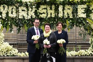 A poignant floral display, made out of 2,000 white Yorkshire roses, reading 'Yorkshire' which demonstrates the discrepancy in survival rates between Yorkshire and the best-performing local authority in England, with one rose representing every life.The charity's chief executive, Kathryn Scott, and Stuart Griffiths, Director of Research and Services, with cancer patient Sara Williamson, centre, from Wakefield.'26th June 2019.'Picture Jonathan Gawthorpe