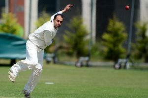Tariq Hussain claimed 4-15 as Batley defeated Ossett to stay second in Championship One.