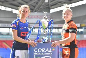 Leeds Rhinos' Courtney Hill, left, and Castleford Tigers' Georgia Roche are pictured with the Women's Challenge Cup.