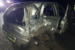 The hideous state of this grey Vauxhall Corsa following a smash on the M1