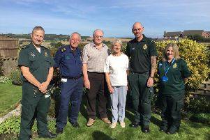 Tony Foster and his wife Janet (centre) are reunited with ambulance crew who helped save his life, Senior Paramedic Team Leader, Damian Walsh, Community First Responder, Peter Gregory, Paramedic, Mark Jackson and Emergency Medical Dispatcher, Shelley Buckley.