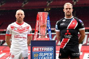 Captains James Roby and Lee Mossop pictured with the trophy they will do battle for at Old Trafford on Saturday. Picture: SWPix