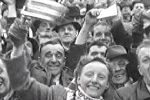 A woman supporter cheers on her team at Wembley. Photo:  Rugby Football League Archive, University of Huddersfield