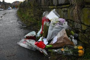 Floral tributes at the collision scene