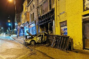 The silver Volvo was reversed into the building and set alight, police have confirmed.