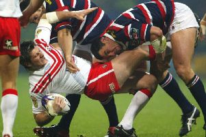John Stankevich of St Helens is tackled by Adrian Morley of the Roosters during the World Club Challenge of 2003