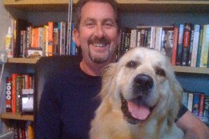 Neil Cossar, author of Brce Springsteen: The Day I Was There, with a furry friend