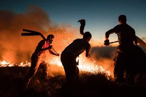 """Firefighters tackling a wildfire on Winter Hill near Bolton. The huge fires that ravaged moorland near Greater Manchester this summer likely had a """"shocking"""" impact on air quality, according to new analysis."""