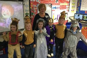Sandra Morris, from Christ Church Haydock, pictured with some of the children from Grange Valley Primary School