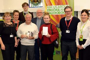 Tilly and John collect their prizes from St Helens Library Service staff at a presentation ceremony at Newton-le-Willows Library