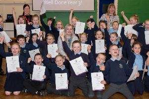 Year three Grange Valley Primary School pupils celebrate after being presented with their Arts Award Discover certificates.