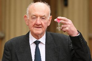 Ray French with his MBE medal, presented by Queen Elizabeth II during an investiture ceremony at Buckingham Palace