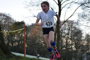 Imogen Atkinson competing at Cross Country